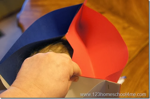 fit to child's head and staple the top together