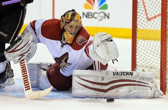 Apr 2, 2014; Los Angeles, CA, USA;   Phoenix Coyotes goalie Thomas Greiss (1) makes a save off a shot by Los Angeles Kings right wing Justin Williams (14) in the second period of the game at Staples Center. Mandatory Credit: Jayne Kamin-Oncea-USA TODAY Sports