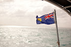 Here, the Turks and Caicos flag flaps in the wind.