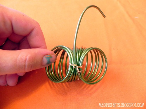 wrap twist tie around the coil