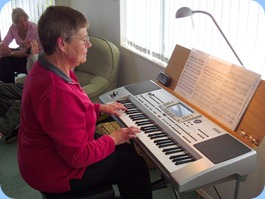 Our gracious host, Pam Rea playing her Korg Pa80