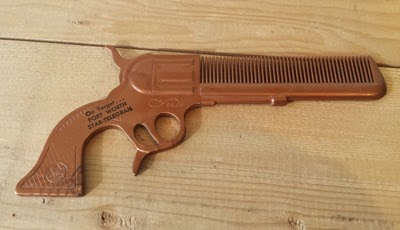 brown toy gun comb