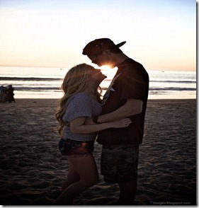 Hug-blonde-couple-beach-sunset-shorts-lovers
