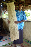 Our Guide Holds Up A Woven Mat:  Most Last 10-15 Years - Suva, Fiji