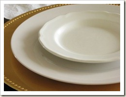 Ironstone plates on golden chargers