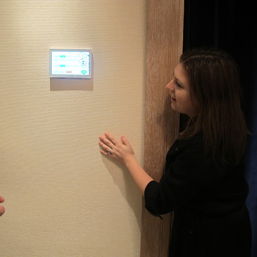 An employee explains how to use the dressing room display screen.