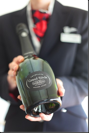 British Airways Cabin Crew with a bottle of Grand S  (Picture by Nick Morrish/British Airways)