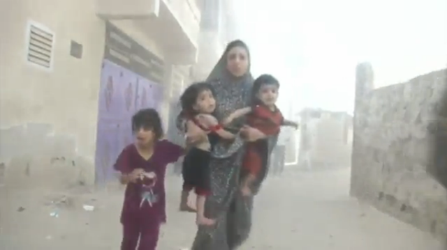family fleeing airstrikes in gaza