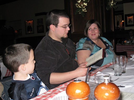 Corey helping out his adoring nephew Eli with the menu.