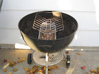 The turkey is grilled on the top grill rack on a cooking rack, so heat evenly flows around it.