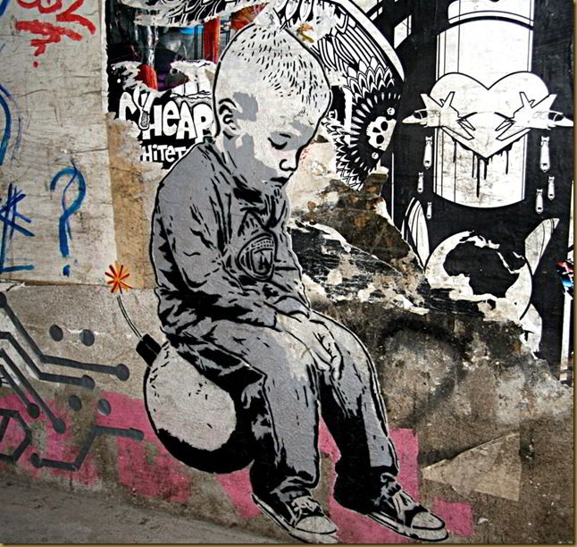 Boy on bomb, street art, Berlin, Germany