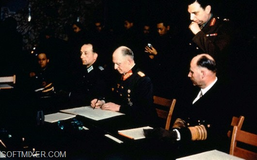 07 May 1945, Reims, Germany --- This photograph relates to the German surrender signing.  Col. General Gustav Jodl signs for Germany at Reims.  General Admiral Hans G. Von Friedeburg of the German delegation is also shown. --- Image by © Bettmann/CORBIS