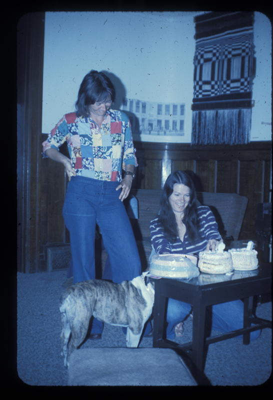 Sisters Brenda & Carolyn Weathers celebrate their sobriety at the Alcoholism Program for Women building (ACW) along with Prissy the bulldog . Circa 1975
