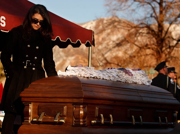 Erin Francom, widow of slain Ogden police Officer Jared Francom, has a quiet moment following the graveside service at the Ogden City Cemetery in Ogden, Utah, Wednesday, January 11, 2012.