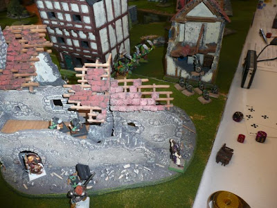Uh oh.  Orc reinforcments charging the ruined house