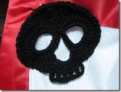 skull apron closeup