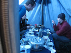 Inside the mess tent. Steven, Simina, Maggie (left to right). Breakfast day 3.