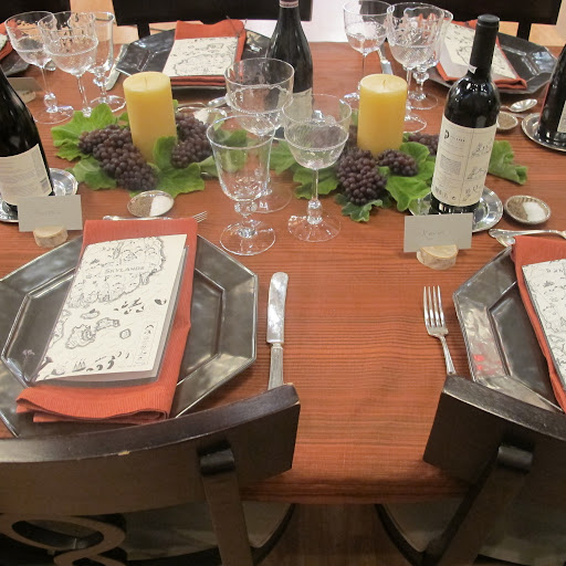 We recreated this table setting from the pages of Martha's new book just for the TV special. Martha loves the faux bois tablecloth that's draped under everything.