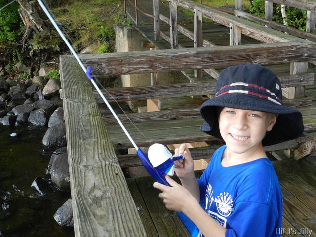 boy fishing on pier