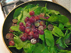 While the steak was in the oven, I used the leftover oil and fat in the skillet to sautee spinach, halved red grapes, a squirt of lemon juice and a sprinkle of nutmeg for a couple of minutes, until the spinach wilted and the grapes were warm.