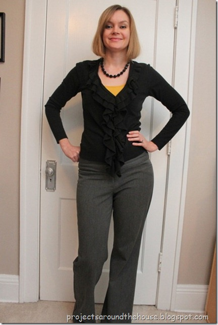 black sweater, mustard cardi, gray pants