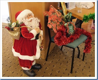 Santa guarding the three raffle prizes on offer from the Entry Desk. A big thank you to Diane Lyons for choosing and wrapping the presents so nicely. Photo courtesy of Dennis Lyons.