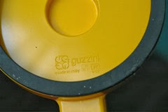 Yellow Guzzini paper towel holder imprint
