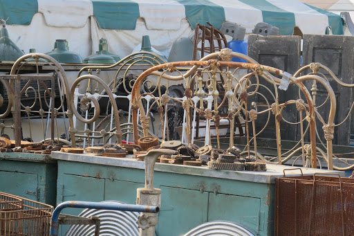 A common site at Brimfield? A myriad of antique wrought-iron beds.