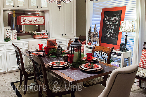 Stunning Red Green Black and plaid Country Christmas inspired Dining room. A truly stunning Christmas Home Tour as part of the Christmas in the Country Blog Tour. This Plaid Inspired Country Christmas will knock your socks off. Features tours of the Living room, Dining Room and a Cocoa hot chocolate bar in the Breakfast room. There is so much inspiration for Christmas decorations in this one post. Be prepared to feel like you are cuddled up by the fire in a warm Northwoods comfy cottage! #country #Christmas #Plaid #Holiday decorating #Holiday ideas #Holidays #Christmas decor #Holiday decor