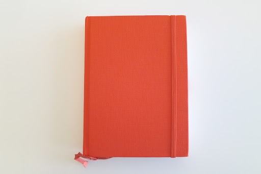 For their guestbook, a simple orange book was used.