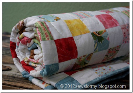 Postage Stamp Quilt Rolled