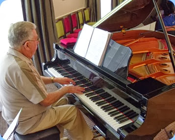 Jim Nicholson playing the Yamaha C3 grand piano