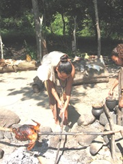 Plimoth Plant indian cook area woman cooking bird2