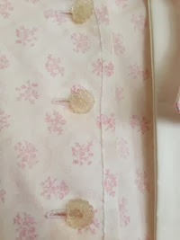 Close up of button and top stitching detail | Lavender & Twill