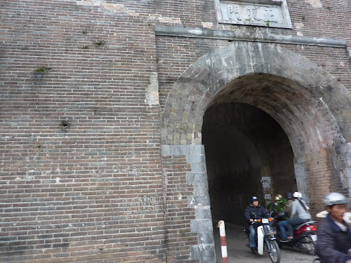 The East gate of the citadel, pockmarked with bullets during the Vietnam war.