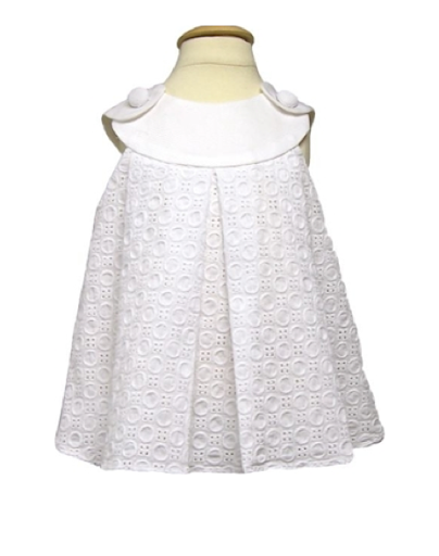 Your little flower girl won't mind wearing this breezy eyelet sundress from Petit Tresor (www.petittresor.com).