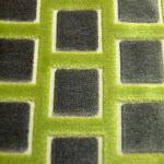 Tkanina obiciowa, trudnopalna. Pluszowa. Motyw geometryczny - krata. Szara, zielona.