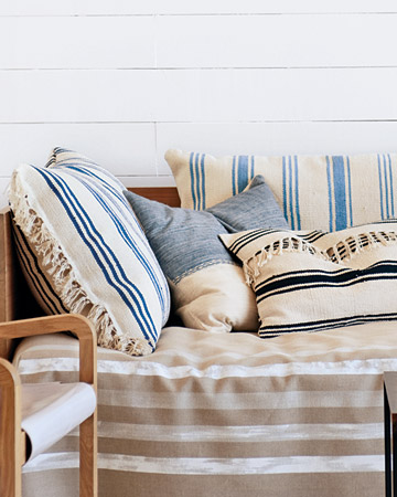 Dress up outdoor furniture by making your own striped pillows and daybed cover.  (marthastewart.com/how-to/striped-rug-pillows)  (marthastewart.com/how-to/striped-daybed_cover)