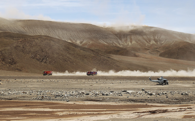 ANTOFAGASTA, CHILE - JANUARY 09:  Trucks race across a valley floor during stage eight of the 2012 Dakar Rally from Copiapo to Antofagasta on January 9, 2012 in Antofagasta, Chile.  (Photo by Bryn Lennon/Getty Images,)