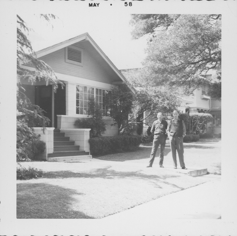 W. Dorr Legg with an unidentified man outside Legg's house. May 1958.