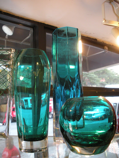 The aqua color of these glass vases gives off the most amazing filter of light.