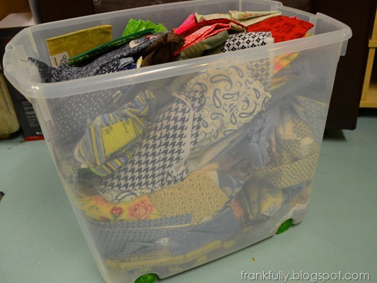 messy fabric in plastic bin