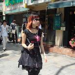Japanese girl wearing sunglasses in Tokyo in Harajuku, Tokyo, Japan