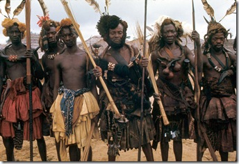 Kuba elders and warriors dressed for the state visit of the Nyim