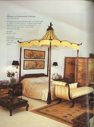 A beautiful mahogany tester bed. The seated figure atop the yellow silk pagoda-esque canopy is just fantastic.