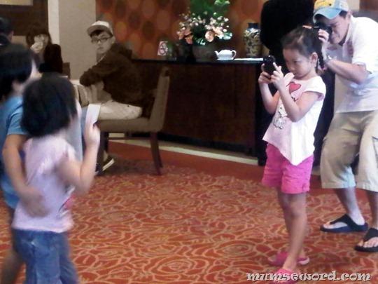 Photographer taking kid Photographer