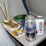 enjoying an asahi and molsen canadian on the flight in Chiba, Tokyo, Japan