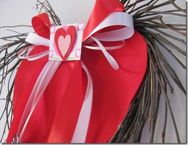 DIY Twig heart wreath with felt heart in the middle.