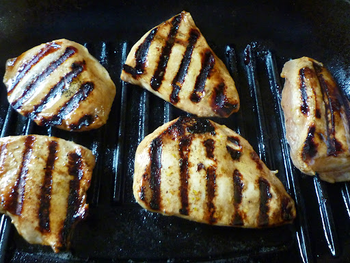 Wait until grill marks show and then turn the chicken over.