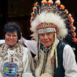 Souix Couple by Reuss Griffiths - People Couples ( breast piece, eagle bonnet, american indian, leather dress )